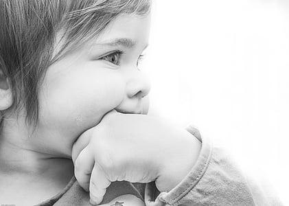 grayscale photo of girl doing thumb-suck