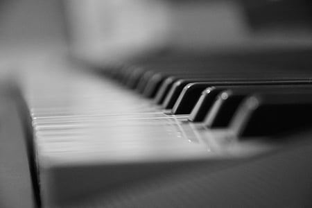 selective focus photo of piano keyboard