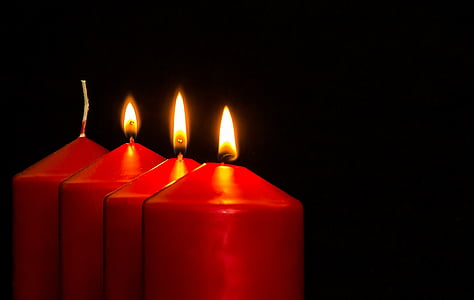 four red candles with lights