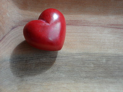 red heart on wooden surface