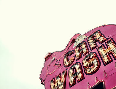 low angle photo of red and brown Car Wash signage