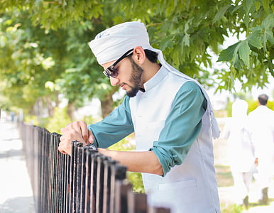 man holding brown fence