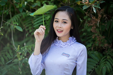 woman wearing purple dress shirt during daytime