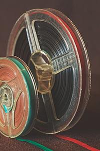 closeup photography of plastic reels