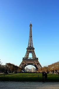 two person standing near Eiffel Tower at Paris
