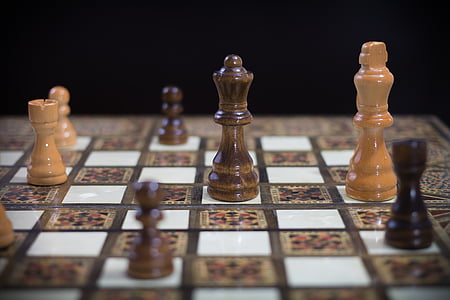 shallow focus photography of Queen chess piece on chess board