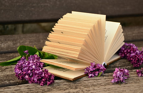 beige book with pink flowers on brown surface