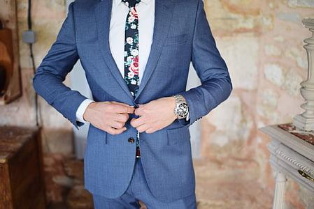 man wearing blue notched lapel suit jacket