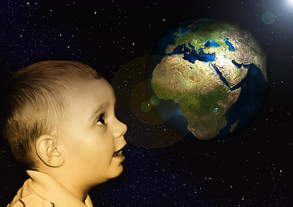 child staring at the planet earth