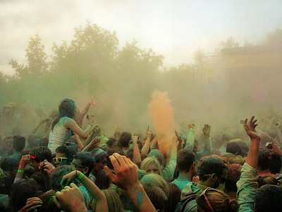 people gathering outside playing with color powders