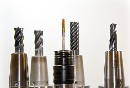 five grey metal drill bits