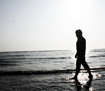 silhoutte of person near body of water