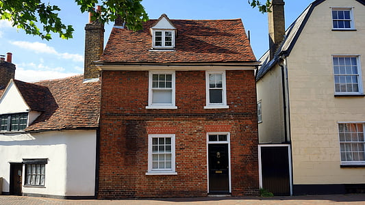 photography of red brick house