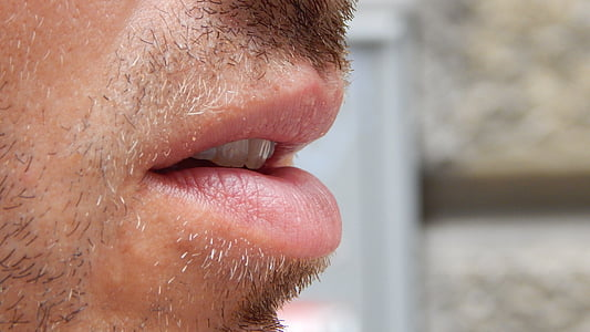 closeup photo of person's mouth