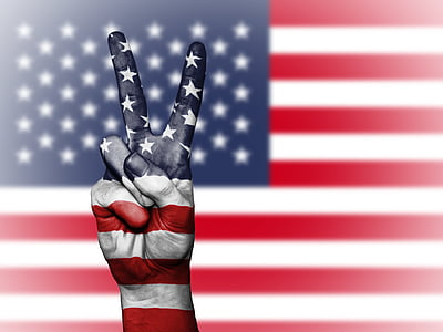 flag of U.S.A and hand peace sign