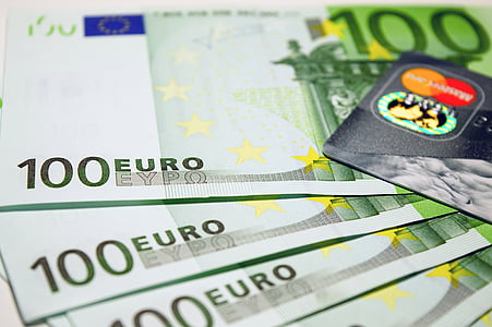 four 100 Euro banknotes and MasterCard card