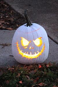 lighted Jack-o-lantern on road