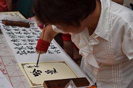 woman writing on yellow paper