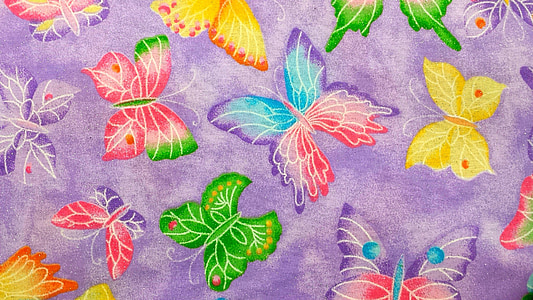 purple and multicolored butterfly printed textile