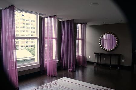 purple window panel hanged on black rod