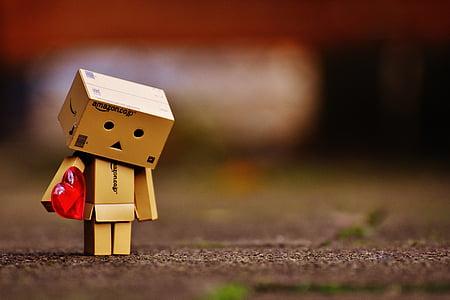 selective focus photography of amazon cardboard box holding heart