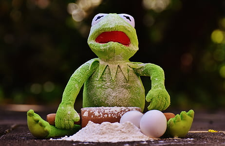 Kermit the Frog holding rolling pin with powder and eggs