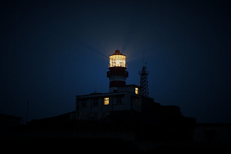 black lighthouse during night