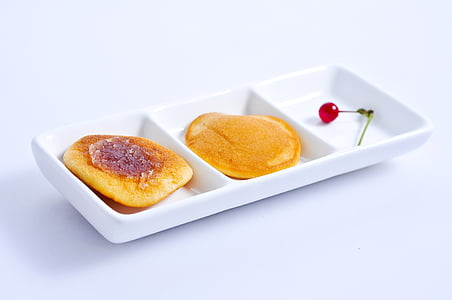 three slotted tray with pancakes and cherry