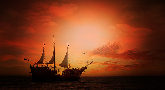 black sail boat on body of water during twilight
