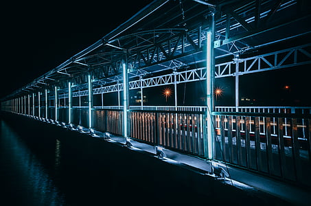 brown concrete bridge with LED lights during nighttime