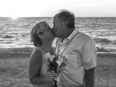 couple kissing near seashore