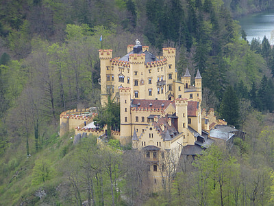 yellow castle near green trees