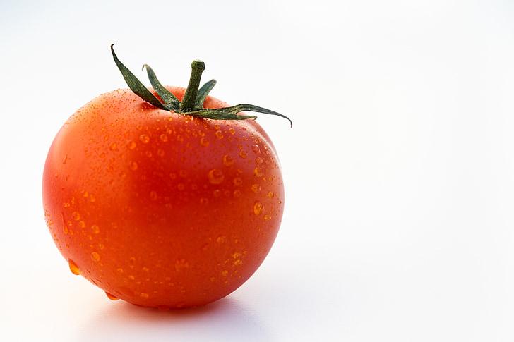 tomato on white table