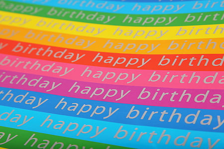 multi-colored background with happy birthday text overlay