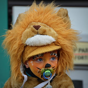 portrait photography of child in lion costume