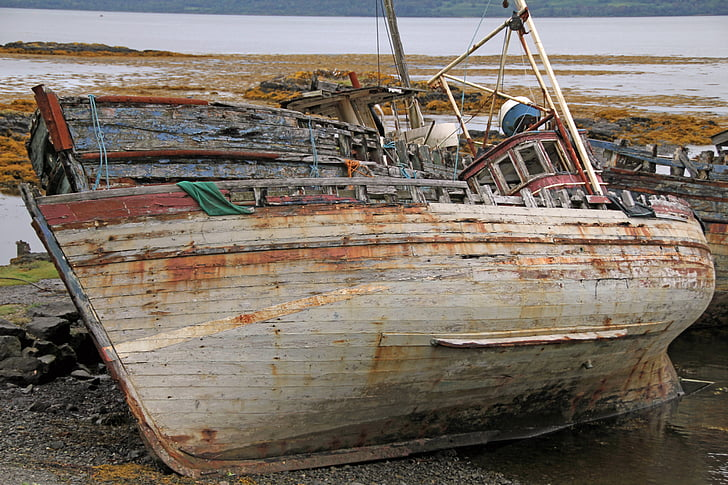rusted white boat on land