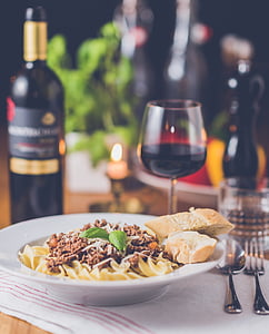 cooked pasta with bread and red wine