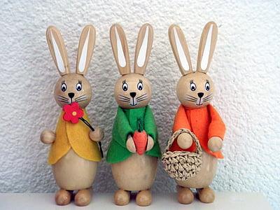 three assorted-color ceramic rabbit figurines