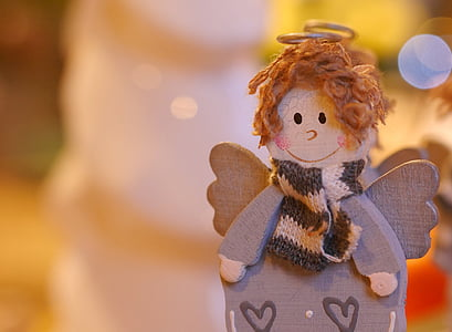 gray and brown angel wooden figurine