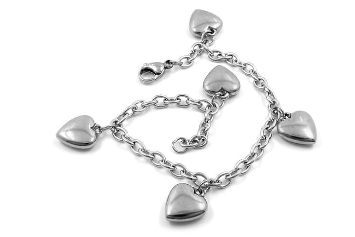 silver-colored heart charm bracelet
