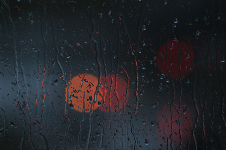 bokeh photography of wet glass