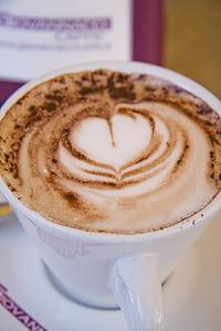 cappuccino on white ceramic cup