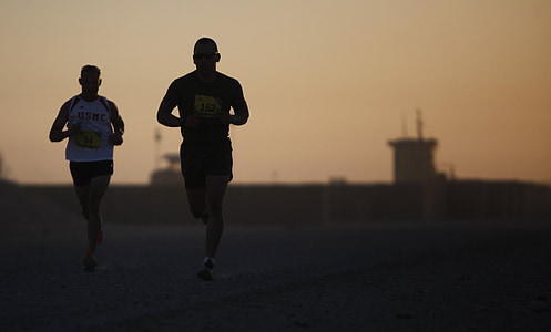 two person jogging photography during sunset