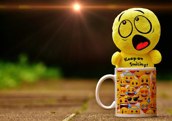 yellow emoji keep on smiling plush toy on emoji print white ceramic mug
