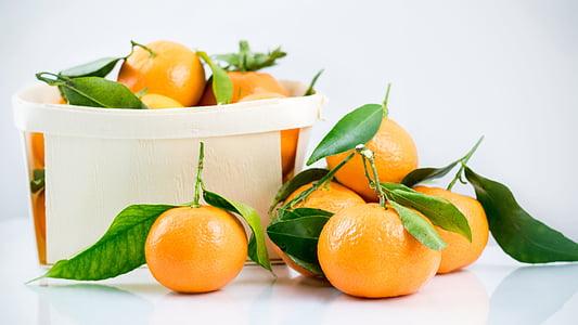 orange fruits in box