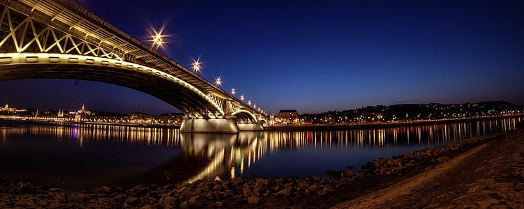 lighted bridge under blue sky
