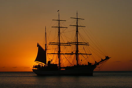 silhouette of galleon ship during sunset