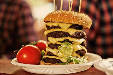 burger patties beside of tomatoes