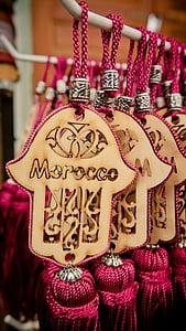 brown and pink hamsa keychain with tassels
