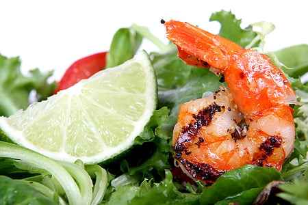 shrimp beside sliced green lime fruit